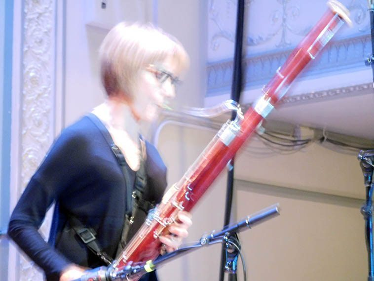 Claire deBrunner at soundcheck for Connie's Memorial at Roulette, Brooklyn -- November 13, 2o16 -- my digital file says that it was 2:06 in the afternoon -- photo by Mark Weber ---- At Claire's Facebook page she posted a photo she took in Barcelona on a recent trip showing a bassoonist on Gaudi's cathedral, kinda where you'd normally see a gargoyle, there's a bassoon player!