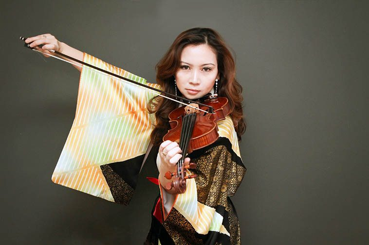 The virtuoso Meg Okura will be visiting on the show today (August 10) and she is very eloquent so I look forward to asking her about the nature of chamber music in jazz ---- Meg Okura is an American violinist who was born in Tokyo (1973) and has been in NYC since at least 1992 (when she studied at Julliard) ----- she is the musical director of her Pan Asian Chamber Jazz Ensemble and the music they have produced is so beautiful it defies mere words ----- photo by Taka Harkness ----- Maybe Meg will bring her erhu, which will give me an excuse to tell my erhu story ---- The erhu is an ancient Chinese 2-string instrument that is bowed, legend has it that the poet LiPo traveled with a troupe of erhu masters as his backup group.