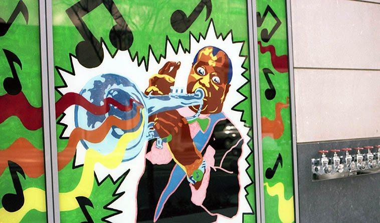 Louis Armstrong window art downtown Washington DC on E Street near 13th ---- March 18, 1995 -- photo by Mark Weber