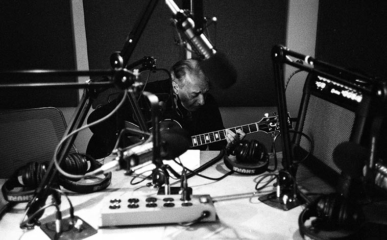 That's the view you have from the control board of your guests: a sea of microphones and wires: Michael Anthony playing live on the Thursday jazz show (and that's the amp I always request he brings, his Quilter, a fabulous guitar amp) -- December 10, 2o15 -- photo by Mark Weber