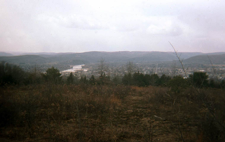 View from Quarry Farm of the Chemung Valley and Chemung River and the town of Elmira (where my Janet grew up) in upstate New York ---- March 27, 1988 ---- Quarry Farm is on East Hill and was the summer home of Mark Twain, this view is directly from where his writing studio used to stand (the renowned Mississippi River Pilot House is now located at Elmira College down below) ---- Twain had such mastery over the English language and one of the largest vocabularies on record (we each have 3 vocabularies: 1) our reading vocabulary 2) our writing vocabulary 3) our speaking vocabulary -- #1 being the largest, we understand more words reading that we don't necessarily use in talking or writing) Now, Twain was so hip -- because it's all about communicating, right? -- He could use an unfamiliar word, but by its placement you knew intrinsically what it meant! Would that we all could be so hip