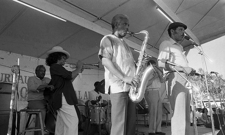 Teddy Edwards Sextet -- July 5, 1980 at Watts Towers Jazz Festival w/ Clora Bryant(trumpet), Fred Carter(trombone), Leroy Vinnegar(bass), Clarence Johnston(drums), Art Hillary(piano), Ernie Andrews(song), Teddy Edwards(tenor) -- photo by Mark Weber
