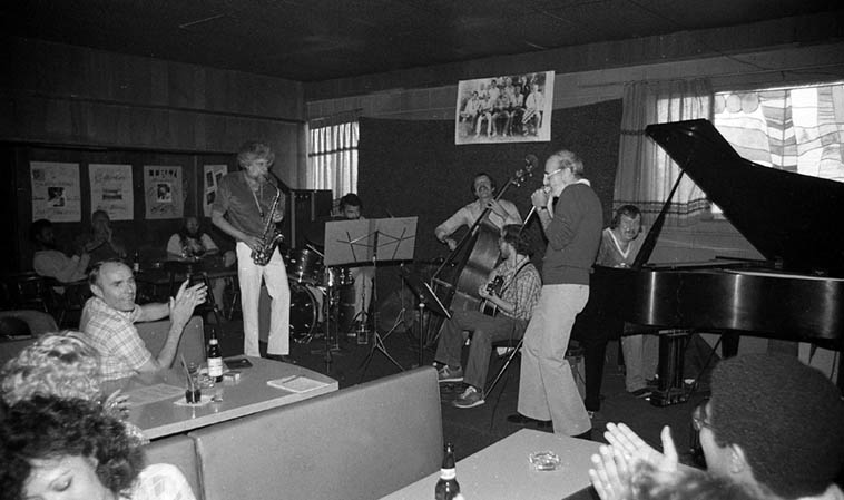 One of my favorite alto saxophonists: Lanny Morgan and his Quartet: Barry Zweig(guitar), Bob Maize(bass), Larry Flahive(piano -- was the house pianist at this club), Nick Ceroli(drums), and sitting in on harmonica: Max Geldray -- May 3, 1981 at Gilberto's, Cucamonga, California -- photo by Mark Weber (Note the photo of Supersax over the bandstand)