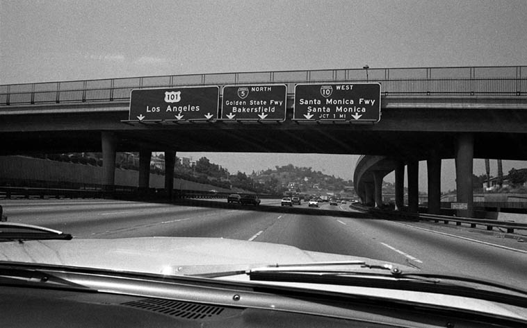 I have drove under those freeway signs about ten thousand times coming from Upland (east of L.A.) and in this shot approaching downtown -- May 9, 1981 -- photo by Mark Weber