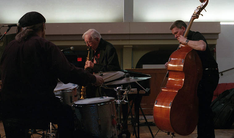 "Arlen Asher Quartet -- John Bartlit(drums), John Blackburn(bass), Jim Ahrend(piano), Milton Arlen Asher(woodwinds) -- March 4, 2o18 @ St Johns United Methodist Church, Albuquerque -- photo by Mark Weber -- They played ""Willow Weep for Me""(flute), ""Summertime""(soprano sax), ""That's a Plenty""(clarinet) and Arlen told story about his early love of Benny Goodman and BG's arrangement on ""That's a Plenty,"" that his very first gig was in a bar at age 13 in Missouri on December 6, 1941 ""the day before the attack on Pearl Harbor."" ""A Flower is a Lovesome Thing""(alto), ""Mirage""(Jim Ahrend comp. w/Arlen on alto), ""Memories of You""(clarinet), ""But Beautiful""(alto flute), ""I Love You""(alto), ""Lost in a Memory""(JA --soprano), ""Honeysuckle Rose/Scrapple from the Apple""(bass clarinet), ""Lush Life""(soprano), and encore ""Over the Rainbow""(alto) with vocal by Michael Herndon -----* My dream is to mount a concert with Sheila Jordan accompanied by Arlen someday (they were born 1928/1929 and both at the top of their game) and would sound fantastic together w/ Alan Broadbent and Cameron Brown (Arlen is all for it, when I told him)"
