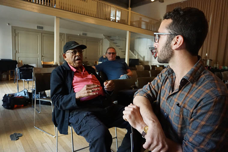 Bradford before the set speaking with fellow cornetist Theo Padouvas with Scott Walton in blue at Community Music Center in the Mission District – July 28, 2o18 – photo by Mark Weber