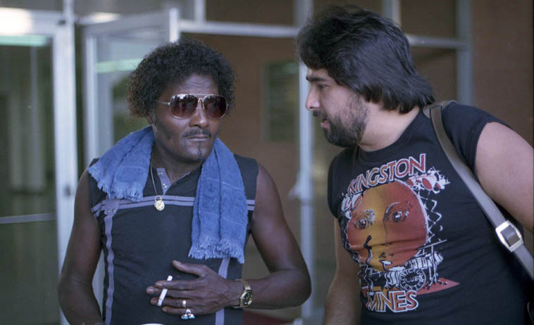 A right-hand guitarist and a left-hand guitarist, backstage at Long Beach Blues Festival: Albert Collins and Coco Montoya – September 15, 1985 – photo by Mark Weber