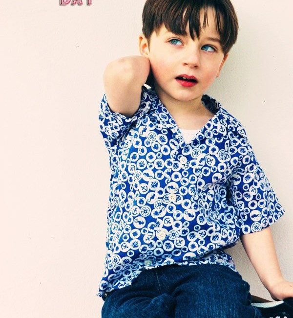 Little boy in blue button down shirt and blue jeans