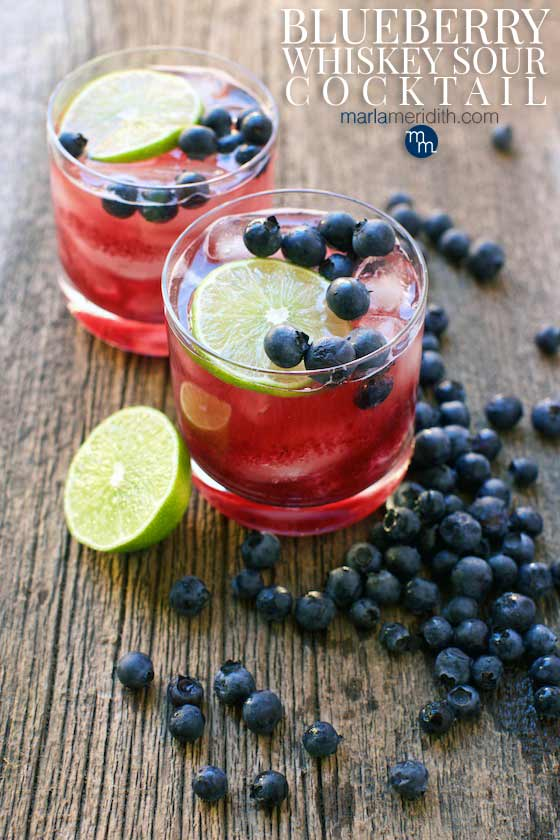 This Blueberry Whiskey Sour cocktail recipe will be a BIG hit at your next celebration or happy hour! MarlaMeridith.com #cocktail #recipe