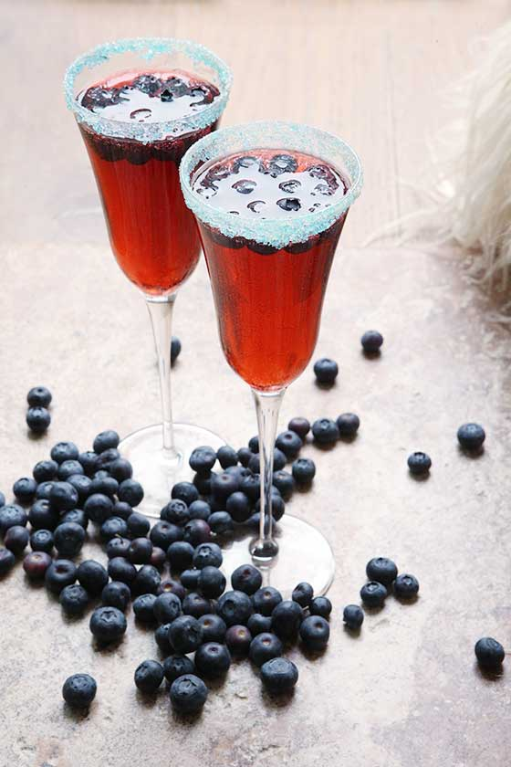Make this delicious Blueberry and Bubbles Punch recipe for New Year's Eve, only a few ingredients make this the perfect cocktail! MarlaMeridith.com