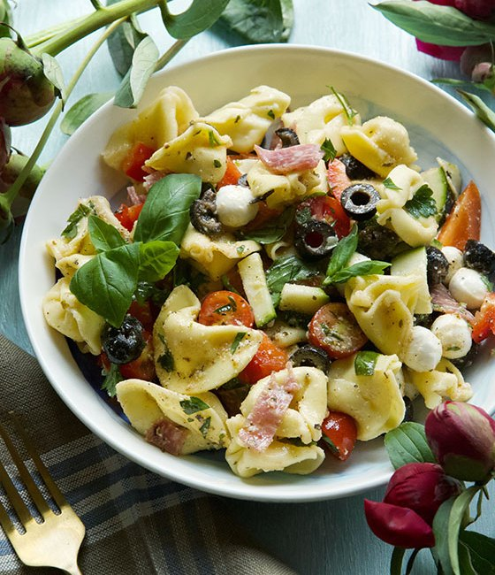 Looking for the perfect dish to serve hungry guests this summer? Look no further than this Delicious, quick and easy Italian Tortellini Salad recipe with homemade dressing. MarlaMeridith.com