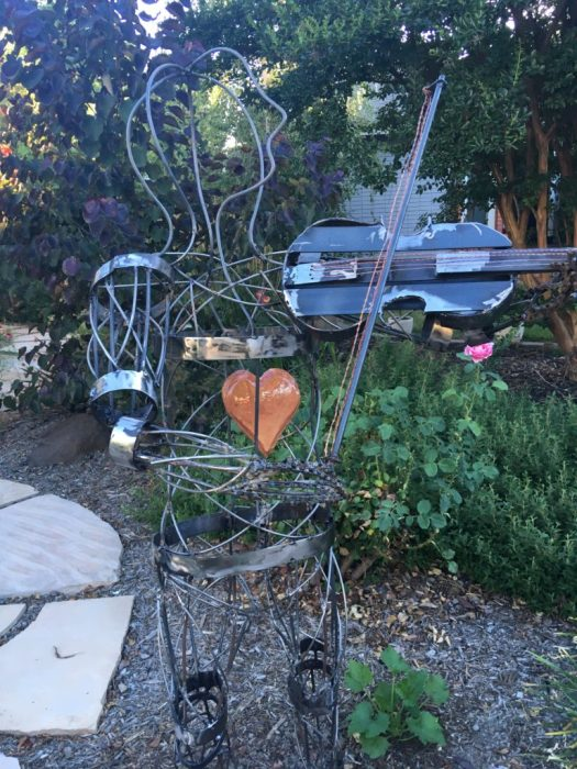 lifesize welded fiddler yard art with copper heart