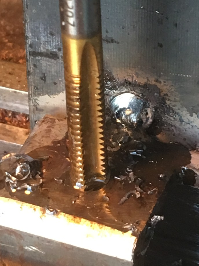 threading a hole in metal