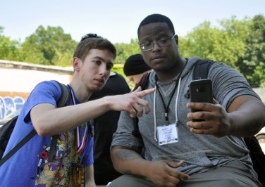 Marlon Craft taking a picture with a fellow participant of MUNY © Katie Green