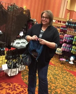 Knitting in the Bijou Basin Ranch Booth at Interweave Yarn Fest 2015