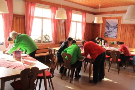 Working with the map at the Gjaid Alm