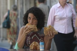 An Israeli woman eats two portions of Falafel, July 15 2007. Falafel, which was invented by Egyptian Bedouins is often referred to as the national dish of Israel. Photo by Orel Cohen/Flash90 *** Local Caption ***