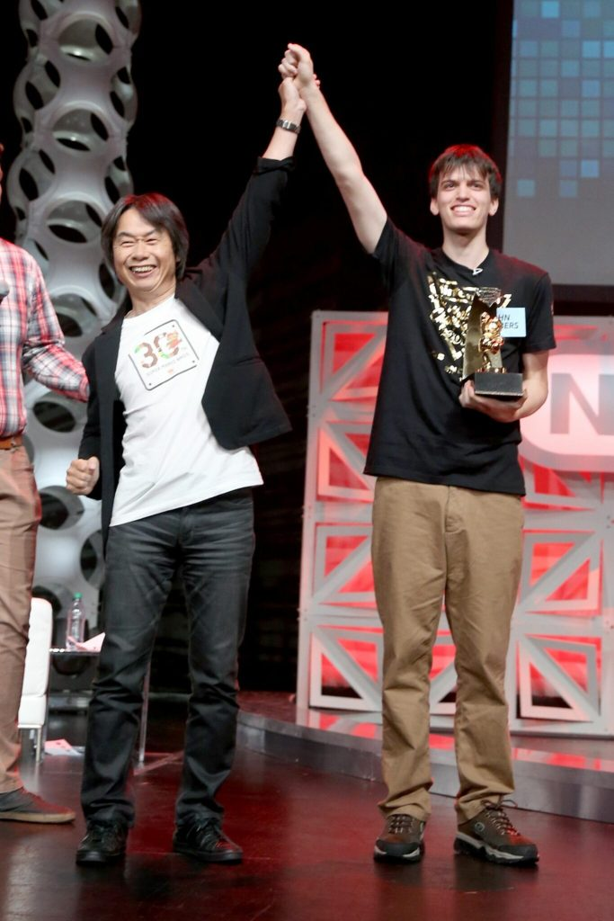 LOS ANGELES, CA - JUNE 14:  In this photo provided by Nintendo of America, 2015 Nintendo World Champion John Goldberg (R) of Queens, New York, receives the grand-prize trophy from video game developer Shigeru Miyamoto, creator of the Super Mario Bros., The Legend of Zelda and Donkey Kong series, among others. Fans in the audience and watching online celebrated the return of the event after a 25-year hiatus and cheered on 16 contestants as they competed across a variety of Nintendo video games.  (Photo by Jonathan Leibson/Getty Images for Nintendo of America)