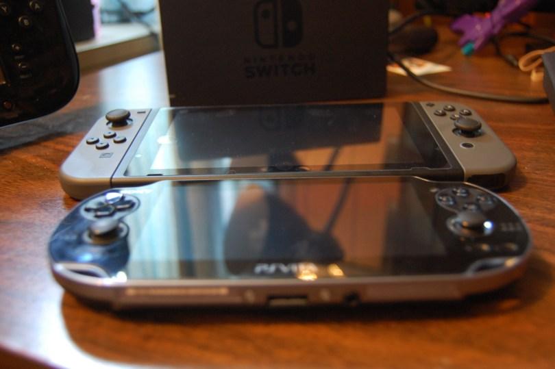 Nintendo Switch next to Vita