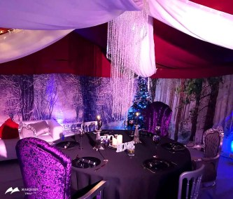 Christmas marquee, beaded lights, grand chairs, winter scene backdrop walls