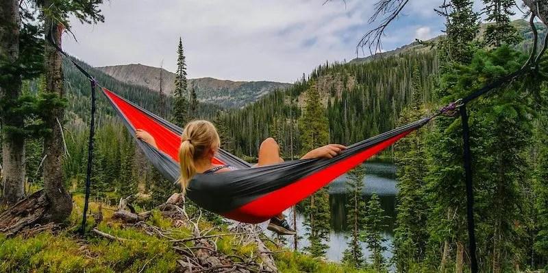 Woman relaxing in a hammock