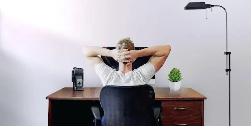 man thinking at computer