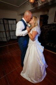 Happy daughter and son embrace at wedding