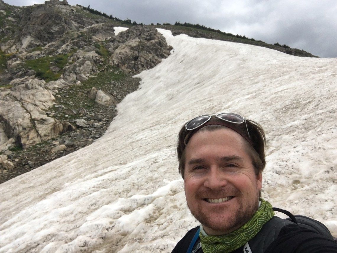 Travel Tips, a selfie of Tim at Saint Mary's Glacier, Colorado
