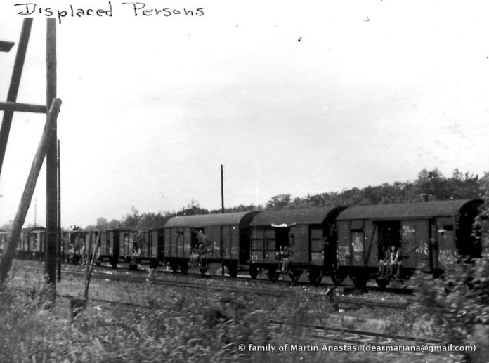 """""""displaced persons"""", heading home via train after liberation of Buchenwald"""