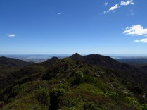 View from Pirongia. That's the west coast and beach over there. Beautiful turquoise blue bays.