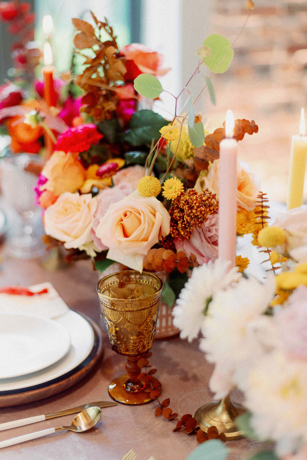 Whimsical and Colorful Wedding Reception Decor, Yellow Tall Candlesticks, Pink, Yellow and Orange Low Floral Centerpiece, Gold Flatware, Yellow Napkin Linen, Wooden Place Card, Vintage Glassware   Tampa Bay Wedding Photographer Dewitt for Love   Linen Rentals Kate Ryan Event Rentals
