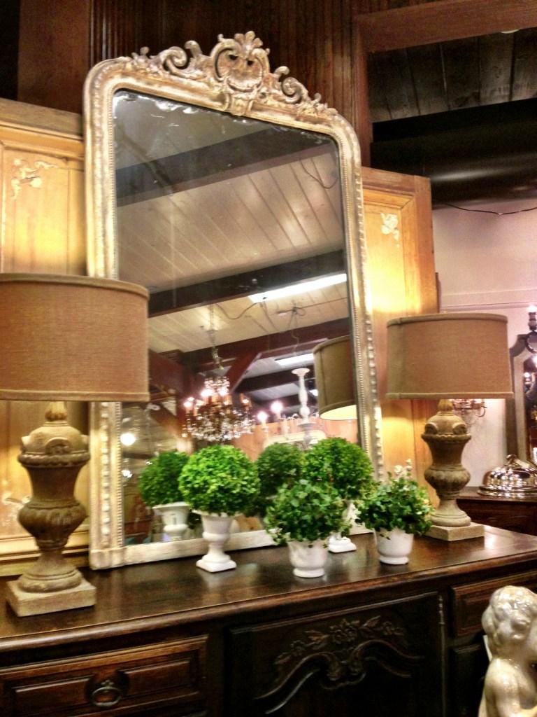 mirror, lamps, topiary