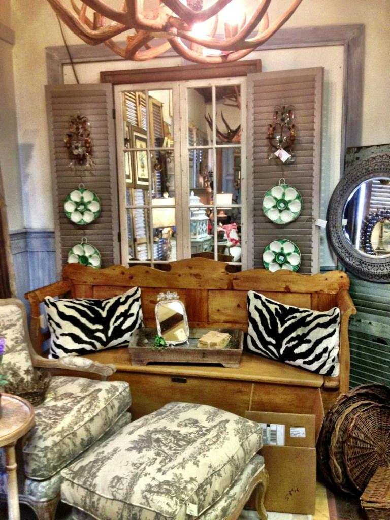 antler chandelier, bench, oyster plates
