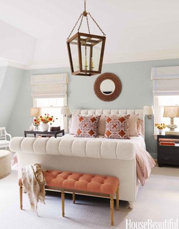 orange bench in bedroom