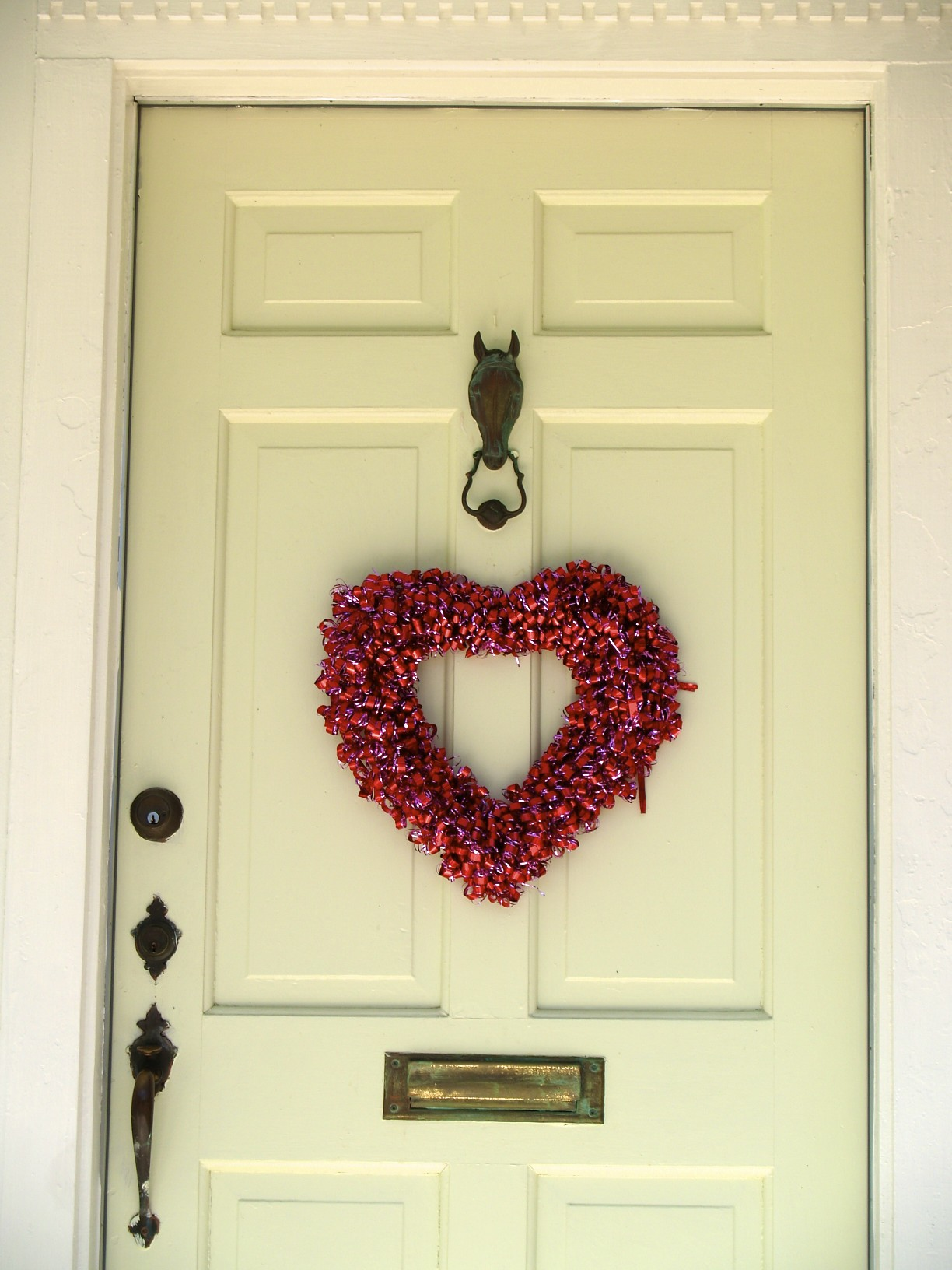 Valentine wreath on door, horse door knocker