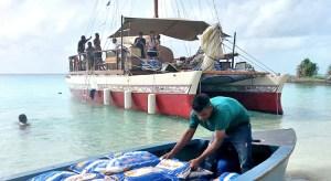 The Okeanos canoe in Maloelap delivering food before Christmas. Photo: Ivanancy Vunikura