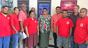 Health Minister Kalani Kaneko (fourth from right) and Health Secretary Julia Alfred (center) signed the agreement with Red Cross Secretary General Jack Niedenthal (second from right) and Red Cross President Dr. Alex Pinano (not pictured). The event was witnesses by Red Cross staff and volunteers.