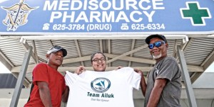 Kwajalein Day canoe race winners Jeffrey Bunglick and Will Alfred joined with canoe co-owner Rosemary Alfred in Majuro for a photo outside the family business. Photo: Hilary Hosia