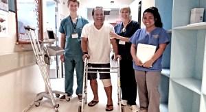 Happy patient Elson Helkena (second from left) wheels his way toward his room accompanied by Canvasback's Kenyon Johnson, Lela Elloway and Mariza Mendoza. Photo: Hilary Hosia.