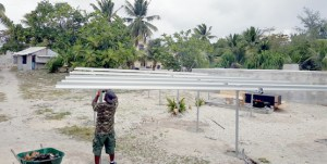 Workers at Enewetak Atoll install platforms for a solar panel array that is now powering a new reverse osmosis water-making unit on the former nuclear weapons test site.