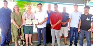 US Ambassador Karen Stewart and her staff present an award to Pan Pacific Foods CEO Wanjun Yang and staff.
