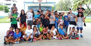 RMI national team players gearing for the Micronesian Games in Yap next month led a week-long series of basketball clinics for youngsters at CMI's SSG Solomon Sam Memorial Sports Court. Photo: Kathleen deBrum.