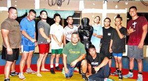 RMI wrestlers going to the Micronesian Games in Yap, from left: Waylon Muller, Kaiser Muller, Isaiah Kramer and Edward Adiniwin have been joined by Bollong Joklur and Kalimen Pabro from Oregon, and Alexander Adiniwin, Richard Adiniwin, Richard Adiniwin, Jr and Andrew Adiniwin all from Hawaii. Photo: Hilary Hosia.