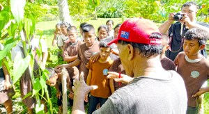 "Laura resident Jabukja Aikne talked to Woja Elementary students last week about the ""what, how and why"" of successful farming in Majuro. Photo: Kelly Lorennij."