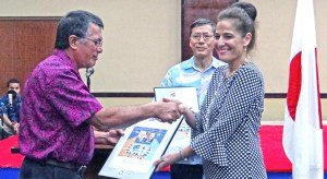 Above, Jennifer Hawley, granddaughter of founding father and first president Amata Kabua was presented with a commemorative stamp from the government of Japan. Photo: Hillary Hosia