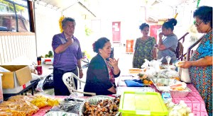 Ebeye residents pick their fresh produce from the MISCo stall in Ebeye.