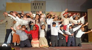 """The Music Man cast dances to the song """"Oklahoma Stubborn"""" during one of six performances at the International Conference Center in Majuro from March 11-16. Photo: Hilary Hosia."""