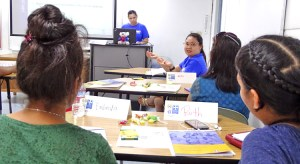 Marshall Islands Epidemiology and Prevention Initiatives (MIEPI) staff members Molly Murphy (at podium) and Maybelline Ipil (facing camera, right) present during the recent mental health responders training program at CMI. Photo: Hilary Hosia.