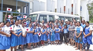 Grateful Assumption students and staff pose with Japan Ambassador Norio Saito and the new bus. Photo: Hilary Hosia.