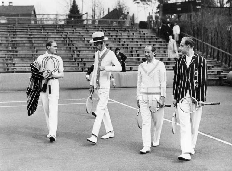 King Gustav of Sweden (in hat) was one of the world's greatest tennis fans. Here he plays a friendly doubles game with Cramm, Heinrich Kleinschroth, and Henner Henkel.